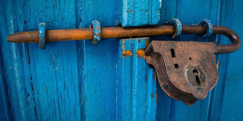 old-lock-on-blue-door